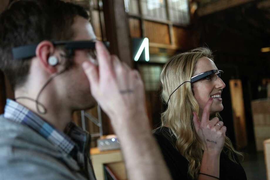 Melanie Neff tries Google Glass during a public preview on Friday, April 4, 2014. The Google device will be available for the public to try on April 5th and 6th. Photo: JOSHUA TRUJILLO, SEATTLEPI.COM / SEATTLEPI.COM