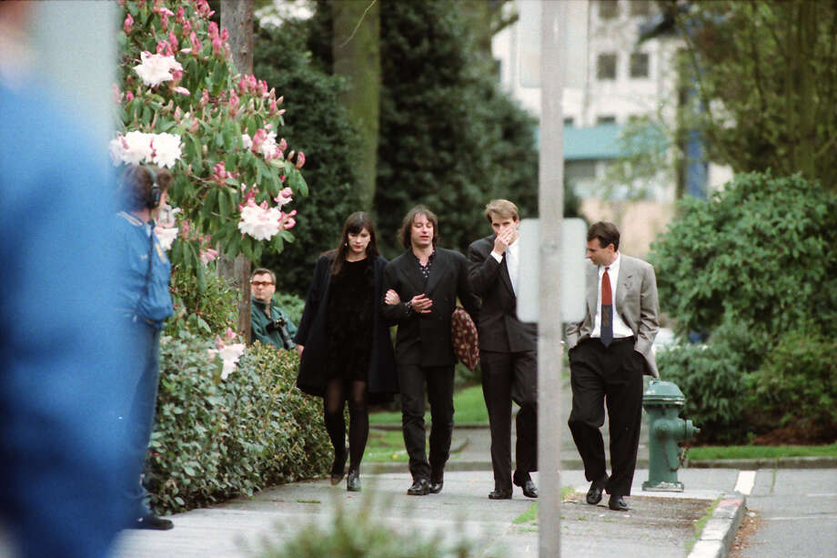 Cobain's memorial on April 10, 1994 attracted both fans and music luminaries, including R.E.M.'s Peter Buck, second from left, and his then-wife and former Crocodile Cafe owner, Stephanie Dorgan, left. Photo: Copyright MOHAI, Seattle Post-Intelligencer collection, 2000.107_19940410_0160.  Photo: MOHAI