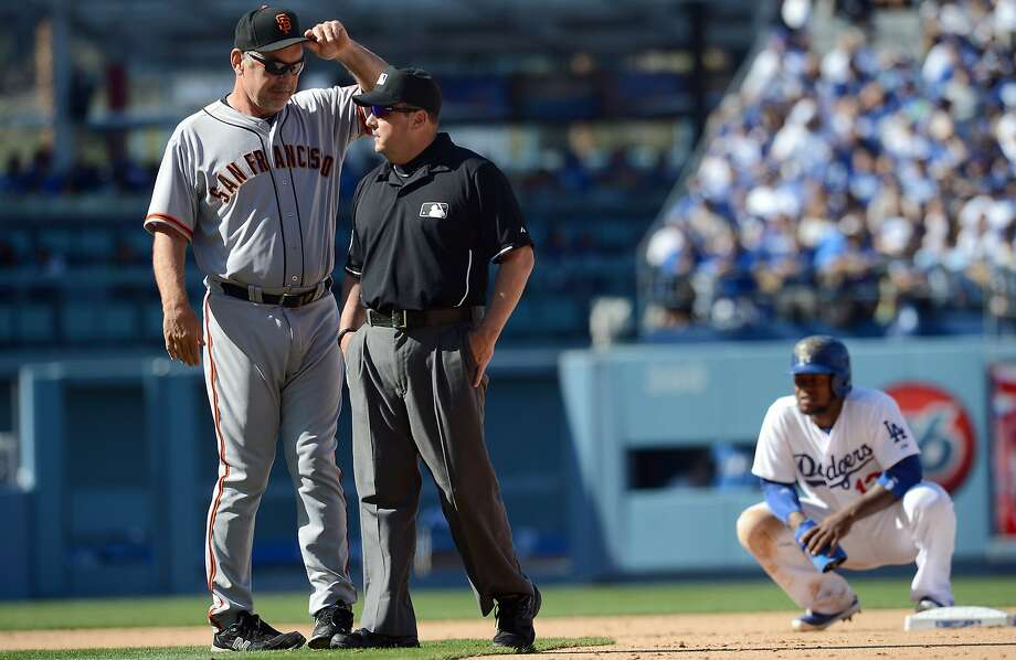 Bruce Bochy requests a review after ump Marty Foster called the Dodgers' Hanley Ramirez safe on a steal attempt Friday. The call was overturned. Photo: Jayne Kamin-Oncea, Reuters