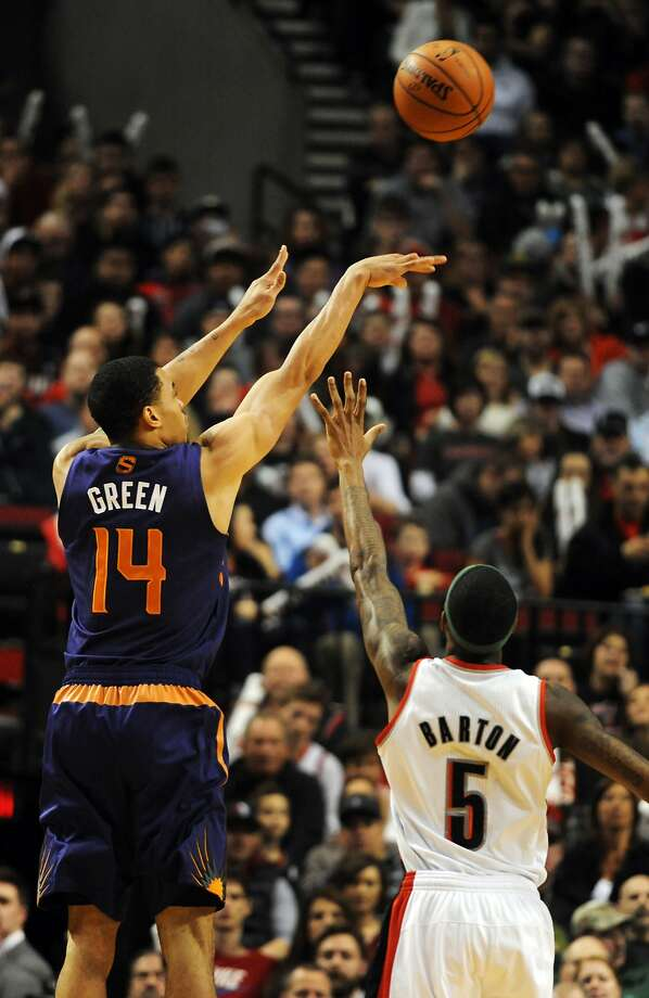 Gerald Green (14) hits a fourth-quarter three-pointer in Phoenix's comeback win. Photo: Steve Dykes, Reuters