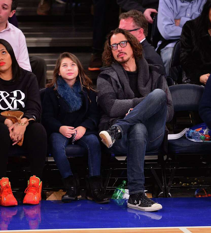 Chris Cornell on Jan. 17, 2014, with his daughter at a Knicks game in Madison Square Garden.  Photo: James Devaney/WireImage, Getty Images / 2014 James Devaney
