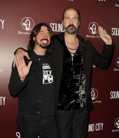 "Dave Grohl (L) and Krist Novoselic on Jan. 31, 2013, at the premiere of ""Sound City"" in Hollywood, California. Photo: Kevin Winter, Getty Images / 2013 Getty Images"