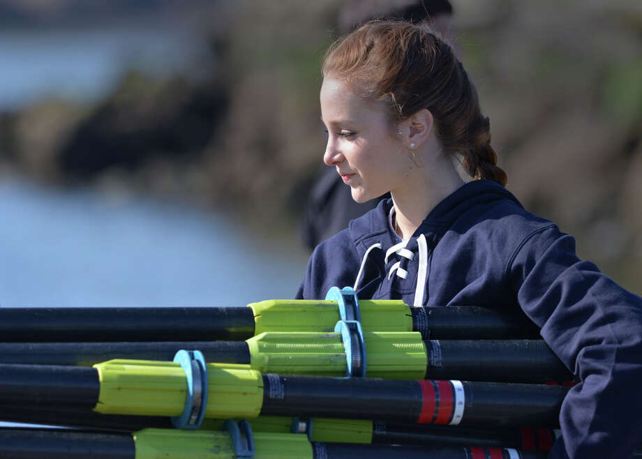 Greenwich Crew member Estelle Forstbauer, 16, carries the oars to the dock during the 11th annual Greenwich Invitational Sprint Regatta on Greenwich Harbor, Greenwich, Conn., Saturday, April 5, 2014. Greenwich Crew hosted the event at Grass Island in Greenwich where 750 junior rowers from the tri-state area competed. Photo: Bob Luckey / Greenwich Time
