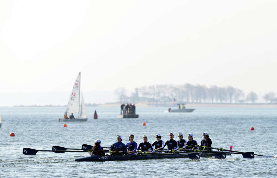 Coxswain, Jimmy Catalano, left, leads a Greenwich Crew team during the 11th annual Greenwich Invitational Sprint Regatta on Greenwich Harbor, Greenwich, Conn., Saturday, April 5, 2014. Greenwich Crew hosted the event at Grass Island in Greenwich where 750 junior rowers from the tri-state area competed. Photo: Bob Luckey / Greenwich Time