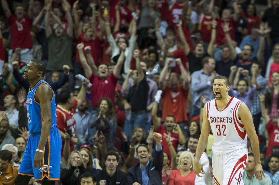 Thunder forward Kevin Durant walks away as Rockets guard Francisco Garcia and the home crowd celebrate after Garcia hit a 3-pointer during the second half. Photo: Smiley N. Pool, Houston Chronicle
