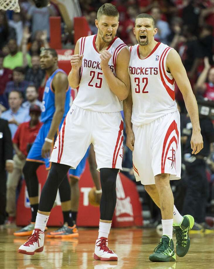 Rockets guard Francisco Garcia celebrates with forward Chandler Parsons after hitting a 3-pointer. Photo: Smiley N. Pool, Houston Chronicle