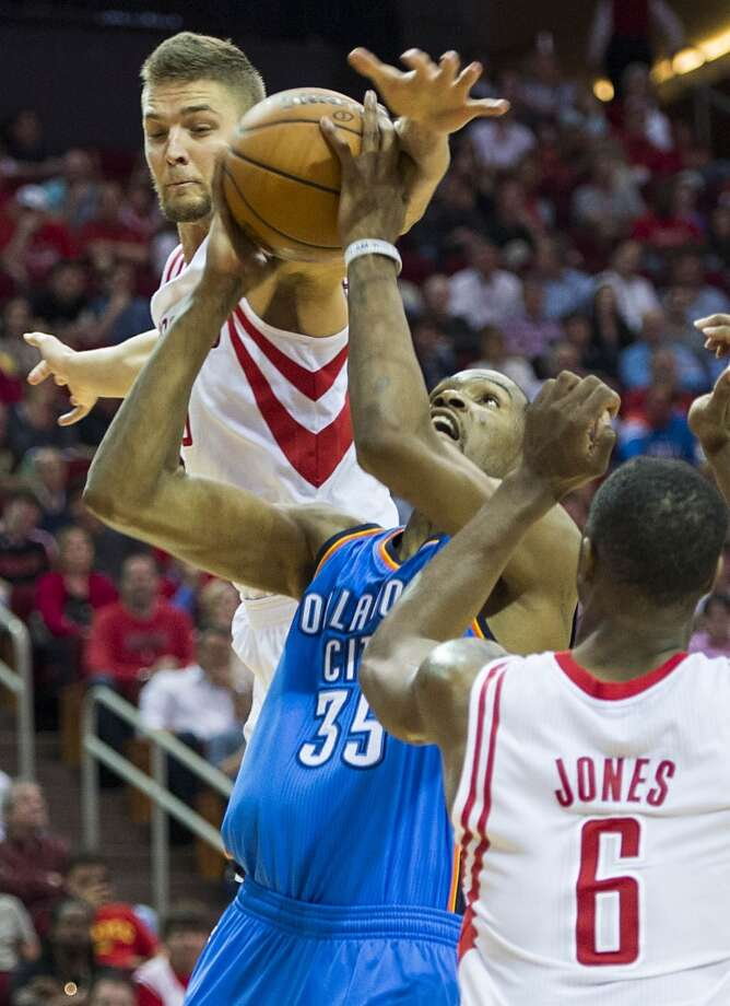 Rockets forward Chandler Parsons defends a drive by Thunder forward Kevin Durant. Photo: Smiley N. Pool, Houston Chronicle