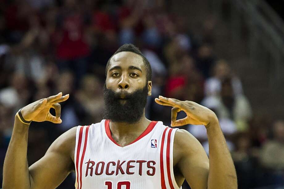 Rockets guard James Harden celebrates after hitting a 3-pointer during the second half. Photo: Smiley N. Pool, Houston Chronicle