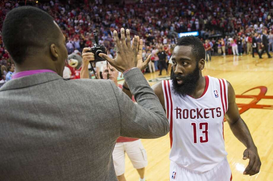 Rockets guard James Harden celebrates with Dwight Howard after a victory over the Oklahoma City Thunder. Photo: Smiley N. Pool, Houston Chronicle
