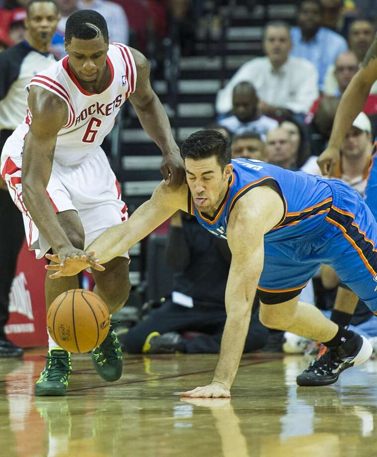 Rockets forward Terrence Jones (6) chases a loose ball against Thunder forward Nick Collison. Photo: Smiley N. Pool, Houston Chronicle