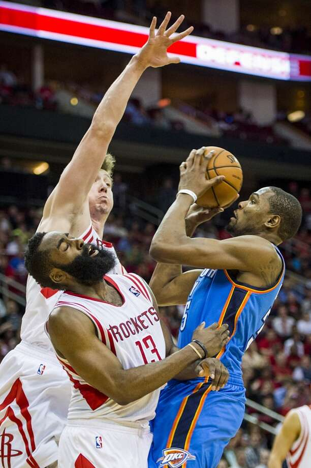 Rockets guard James Harden (13) and center Omer Asik (3) defend against Thunder forward Kevin Durant. Photo: Smiley N. Pool, Houston Chronicle