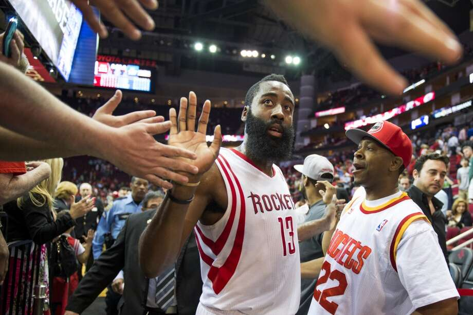 Rockets guard James Harden celebrates with fans after the victory. Photo: Smiley N. Pool, Houston Chronicle