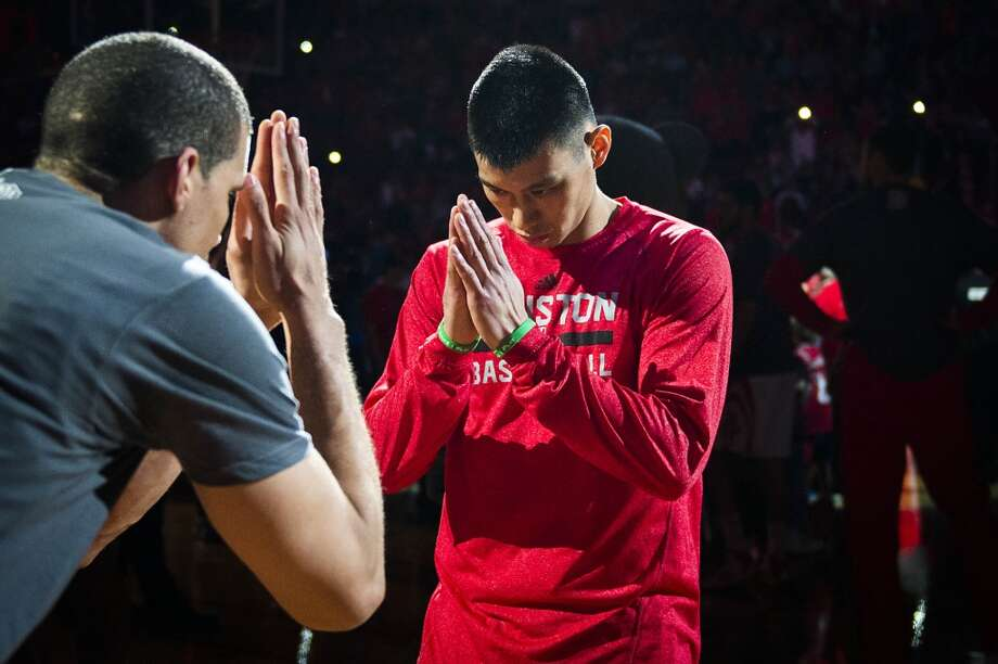 Rockets guard Jeremy Lin bows toward guard Francisco Garcia before the game. Photo: Smiley N. Pool, Houston Chronicle