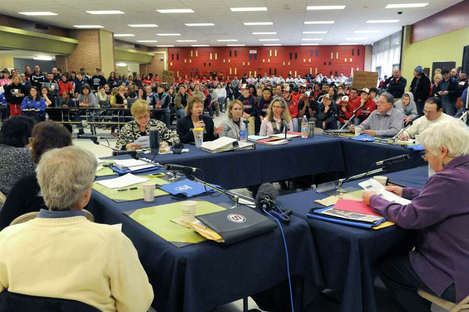 The Schenectady school board meets on Saturday April 5, 2014 in Schenectady, N.Y. Schenectady High School students were out in force on Saturday morning to protest the school boarda€™s proposed elimination of the districta€™s sports programs. (Michael P. Farrell/Times Union) Photo: Michael P. Farrell / 00026387A