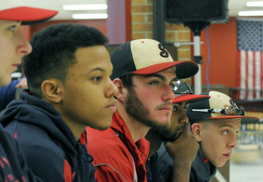 Members of the Schenectady High School baseball team listen intently during a school board meeting on Saturday April 5, 2014 in Schenectady, N.Y. Schenectady High School students were out in force on Saturday morning to protest the school boarda€™s proposed elimination of the districta€™s sports programs. (Michael P. Farrell/Times Union) Photo: Michael P. Farrell / 00026387A