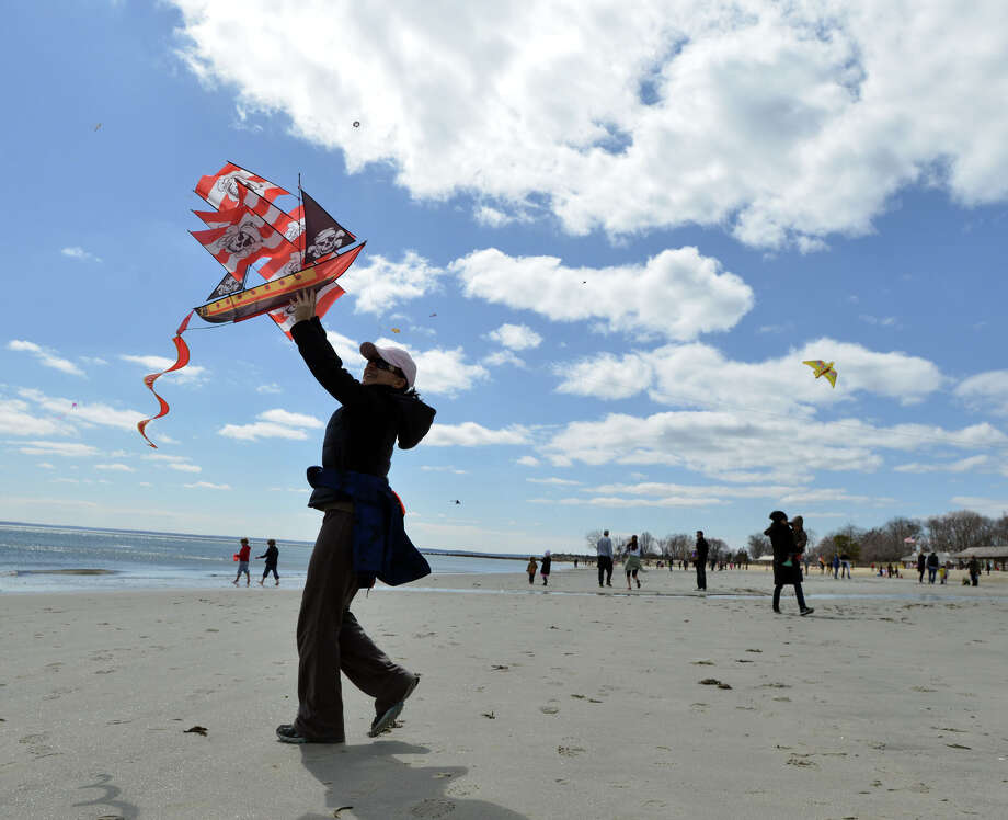 Nora Parry of Riverisde launches her pirate ship kite into the air during the annual Kite Flying Festival sponsored by the Greenwich Arts Council and the Town Department of Parks and Recreation at Greenwich Point, Saturday, April 5, 2014. Photo: Bob Luckey / Greenwich Time