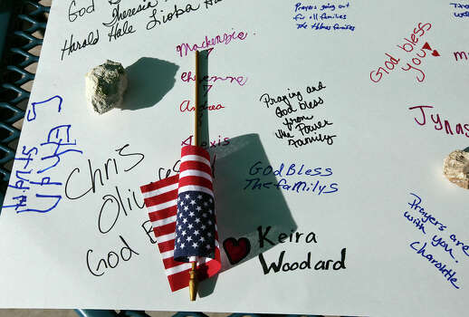Detail of messages of support and a American flag on a poster board during a flag walk around Lions Club Park in tribute to the Fort Hood shooting victims Friday April 4, 2014 in Killeen, Texas. Photo: Edward A. Ornelas, San Antonio Express-News / ©2014 San Antonio Express-News