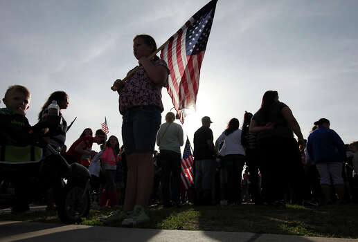 People gather for a flag walk around Lions Club Park in tribute to the Fort Hood shooting victims Friday April 4, 2014 in Killeen, Texas. Photo: Edward A. Ornelas, San Antonio Express-News / ©2014 San Antonio Express-News