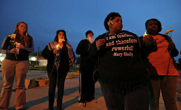 People take part in a candle light vigil for the Fort Hood shooting victims at the east gate Friday April 4, 2014 in Killeen, Texas. Photo: Edward A. Ornelas, San Antonio Express-News / ©2014 San Antonio Express-News