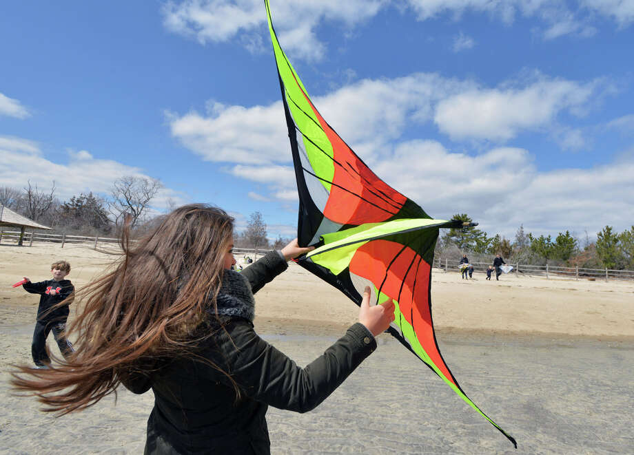 Alina Schellenberg of Düsseldorf, Germany, flies her kite during the annual Kite Flying Festival sponsored by the Greenwich Arts Council and the Town Department of Parks and Recreation at Greenwich Point, Saturday, April 5, 2014. Photo: Bob Luckey / Greenwich Time