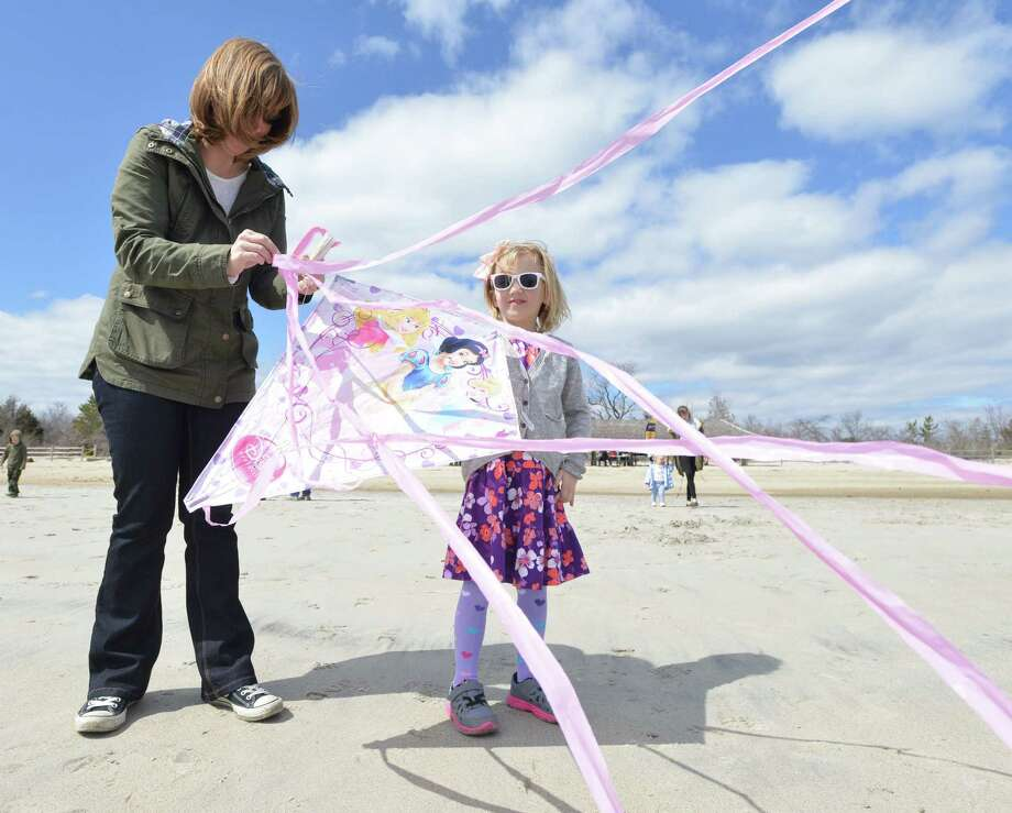 Laura Buckingham, left, and her daughter, Ellie, 5, of Old Greenwich, untangle their princess kite during the annual Kite Flying Festival sponsored by the Greenwich Arts Council and the Town Department of Parks and Recreation at Greenwich Point, Saturday, April 5, 2014. Photo: Bob Luckey / Greenwich Time