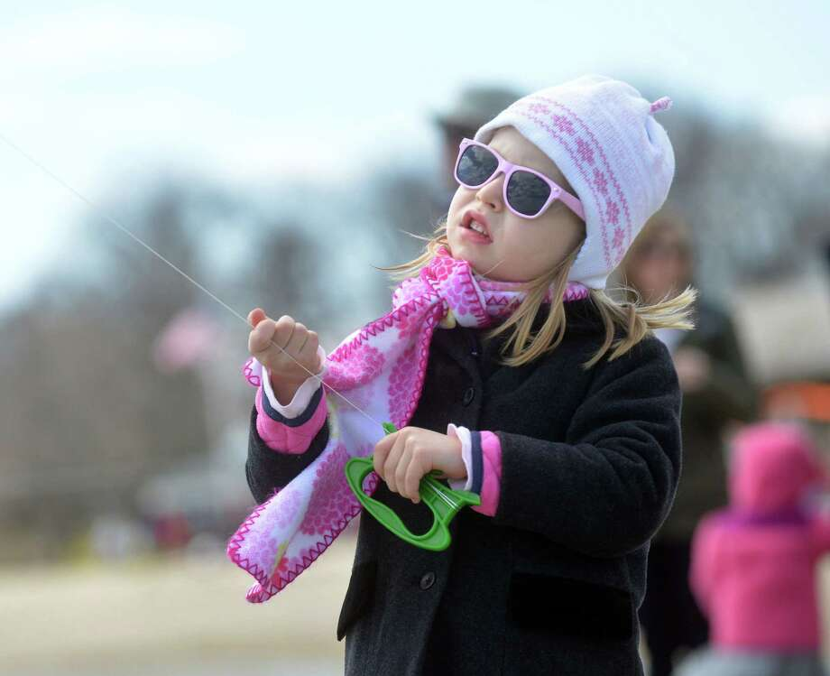 Kate Perera, 5, of Old Greenwich, during the annual Kite Flying Festival sponsored by the Greenwich Arts Council and the Town Department of Parks and Recreation at Greenwich Point, Saturday, April 5, 2014. Photo: Bob Luckey / Greenwich Time
