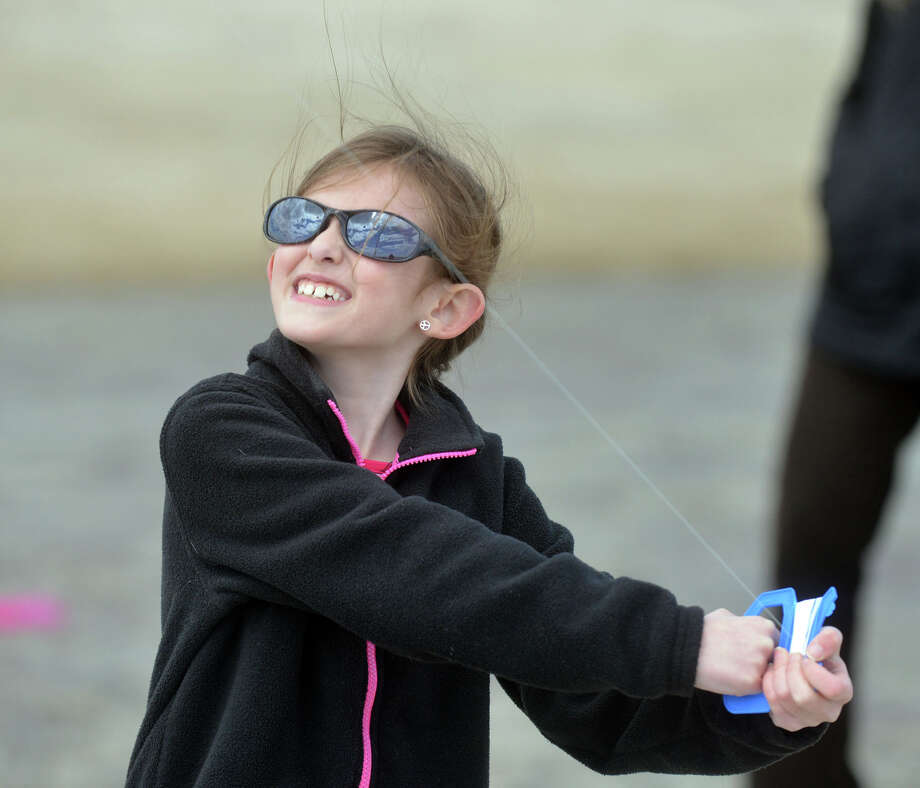 Sarah Tocci, 8, of Greenwich, during the annual Kite Flying Festival sponsored by the Greenwich Arts Council and the Town Department of Parks and Recreation at Greenwich Point, Saturday, April 5, 2014. Photo: Bob Luckey / Greenwich Time
