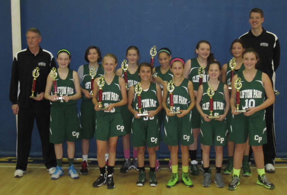The Clifton Park Biddy A Monsters 5th/6th grade girls travel basketball team includes (back row, from left):  Coach Gary Watrobski, Kaitlyn Watrobski, Nicole Cheetham, Paige Canterbury; Simone Walker, Lindsey Geary, Ashley Shields and coach Jim Shields. Front row: Emily Carroll, Sara Stalica, Molly Zahnleuter, Bella Tearno and Megan Huerter.