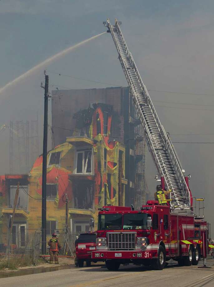 Firefighters battled a five-alarm blaze on March 25 at an apartment complex under construction on West Dallas near Montrose. The five-story, 368-unit building was destroyed. Photo: Johnny Hanson, Staff / © 2014  Houston Chronicle