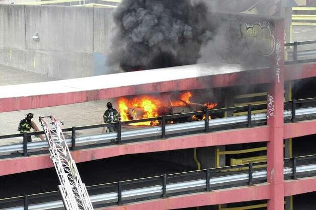 Photos car ablaze atop albany parking garage times union for Garage ww auto