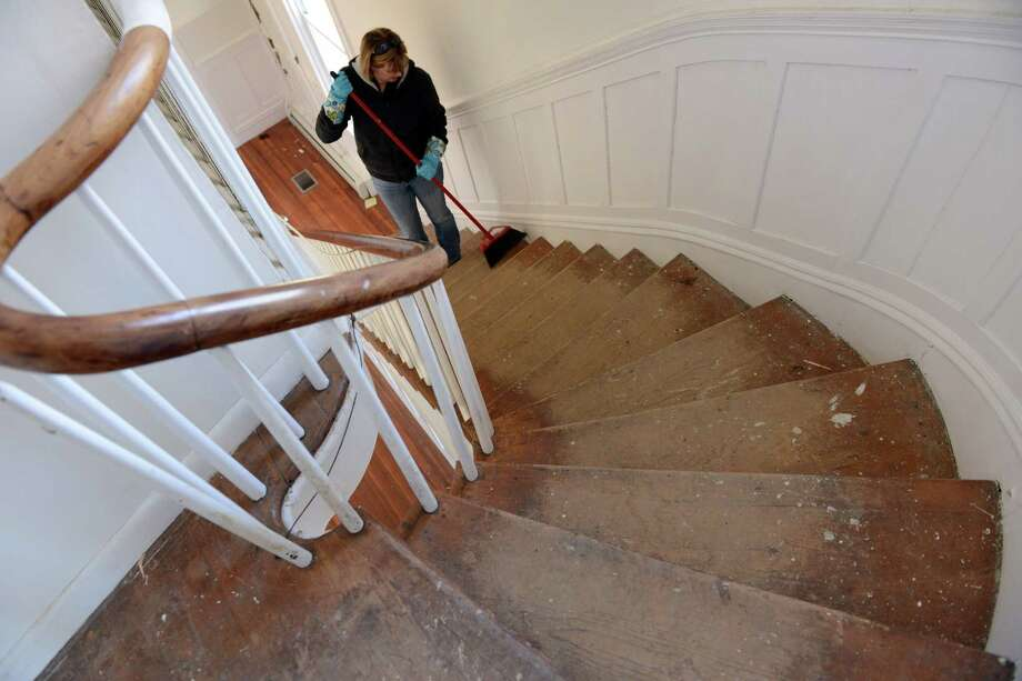 Sue Wright, board president of the Mighty Quinn Foundation, sweeps the stairs at the house on the grounds of the former American Shakespeare Theatre in Stratford, Conn. Saturday, April 5, 2014. Volunteers are refurbishing it for The Shakespeare Academy @ Stratford, a summer acting program for college students that will be starting there in July. The house cleanup and the summer academy is being organized by the Mighty Quinn Foundation, named for Wright's son, 19-year-old Quinn Rooney, who loved acting and Shakespearean plays and passed away from a rare form of brain cancer in June 2012. Photo: Autumn Driscoll / Connecticut Post