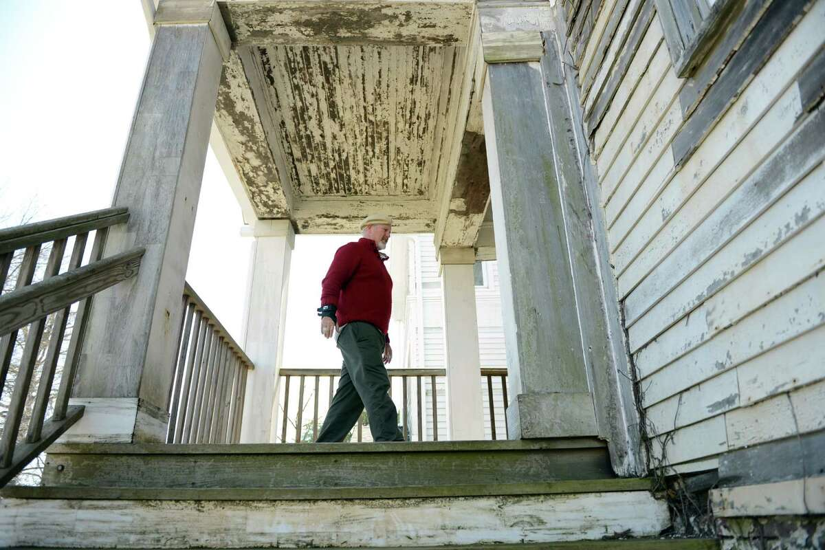 Eddie Goodrich, chairman of the Stratford Arts Commission, walks across the deck of the house on the grounds of the former American Shakespeare Theatre in Stratford, Conn. Saturday, April 5, 2014. Volunteers are helping to refurbish it for The Shakespeare Academy @ Stratford, a summer acting program for college students that will be starting there in July. The house cleanup and the summer academy is being organized by the Mighty Quinn Foundation, named for 19-year-old Quinn Rooney, who loved acting and Shakespearean plays.