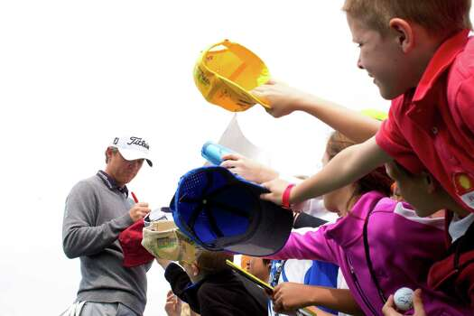 Matt Jones signs autographs after finishing the third round of the Shell Houston Open. Jones ended the round third place, Saturday, April 5, 2014, in Humble. Photo: Marie D. De Jesus, Houston Chronicle / © 2014 Houston Chronicle