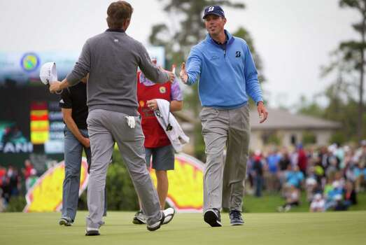 Matt Kuchar, right, leader of the Shell Houston Open third round, shakes hands with Matt Jones, left, who ended third, Saturday, April 5, 2014, in Humble. Photo: Marie D. De Jesus, Houston Chronicle / © 2014 Houston Chronicle