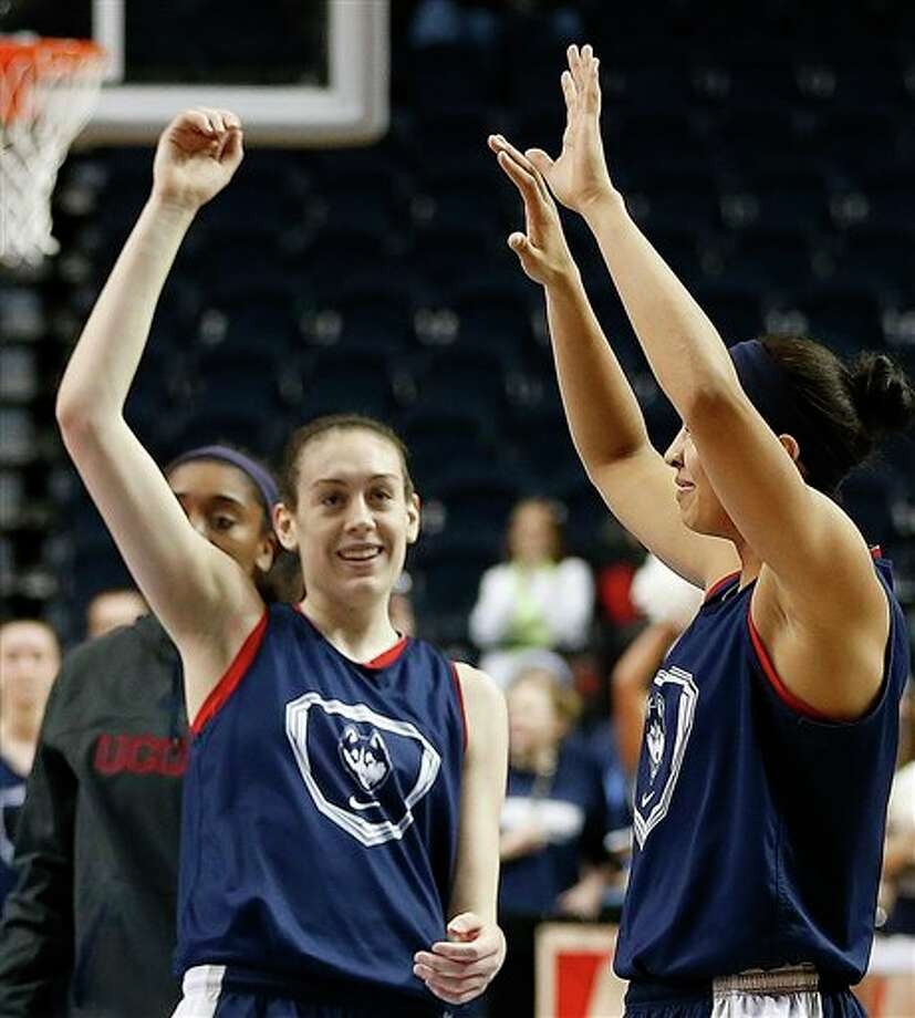 Connecticut forward Breanna Stewart, left, waves to fans during practice before the women'sFinalFour of the NCAA college basketball tournament, Saturday, April 5, 2014, in  Nashville, Tenn. Connecticut plays Stanford Sunday. (AP Photo/Mark  Humphrey)