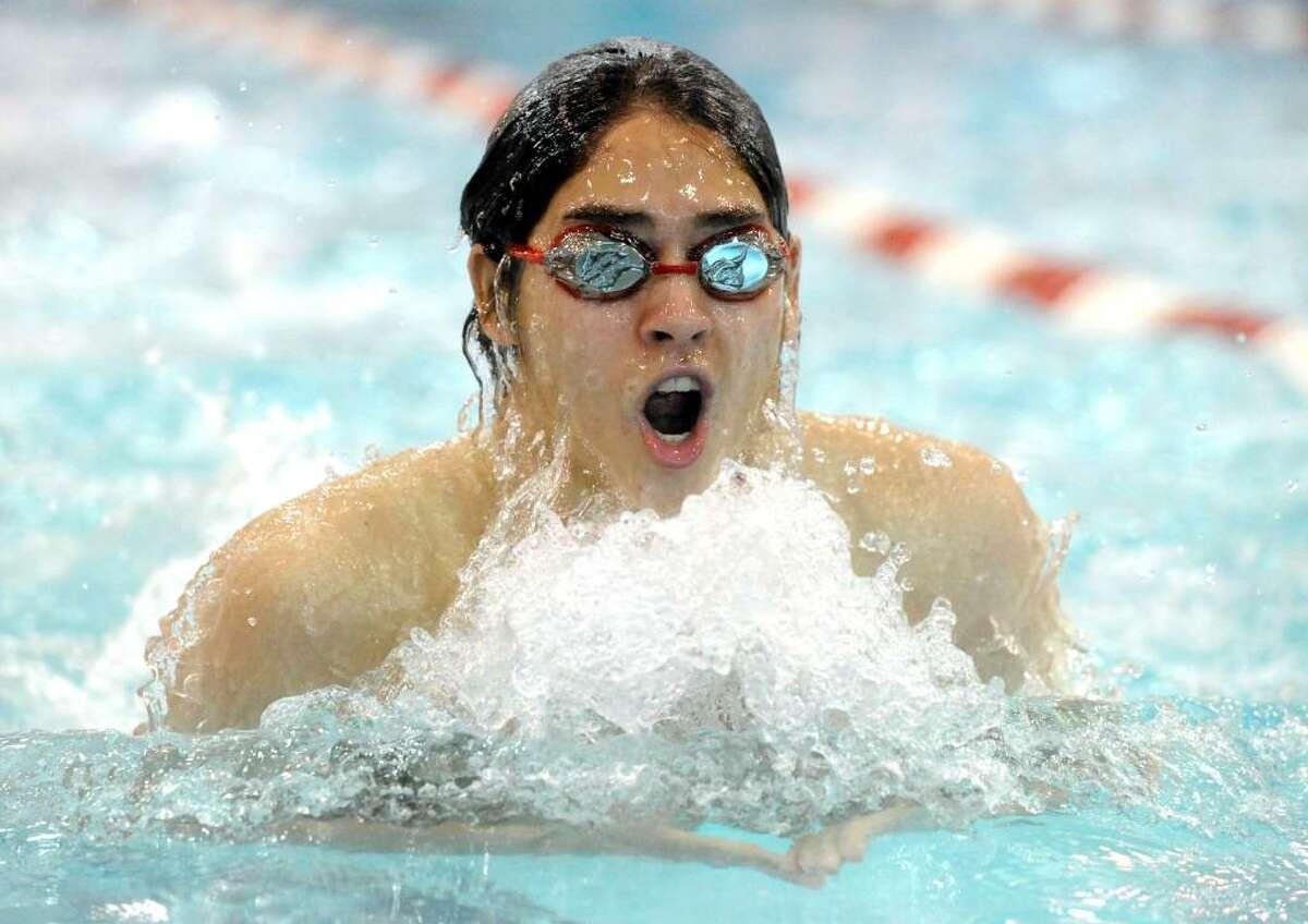 Greenwich's Tony Martir swims the breaststroke leg of the 200 medley relay earlier this season.