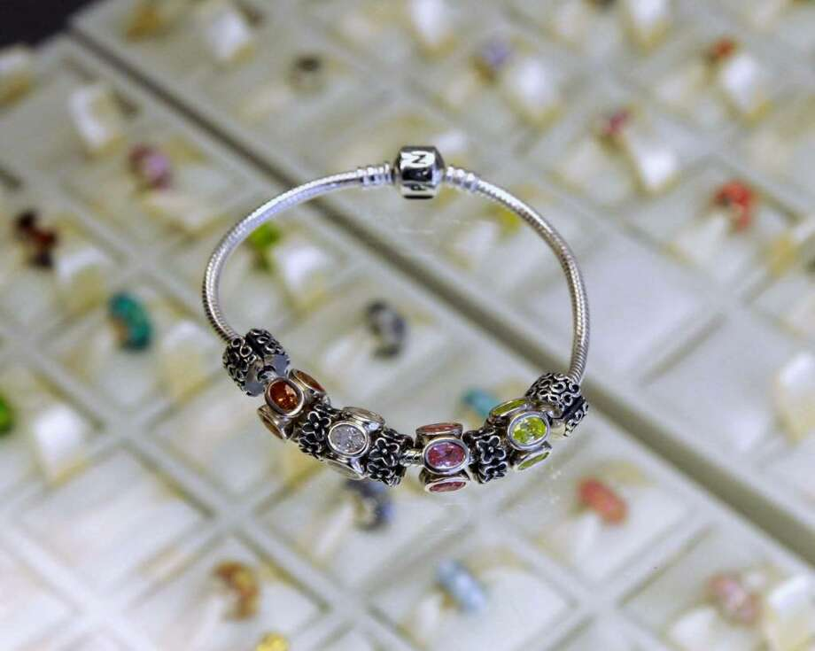Faltom Jewelers on Main st. in Danbury are finding that Pandora jewelry have become very popular in the past few years. There are many Pandora charms to choose from. Pictured here is a Pandora bracelet. Tuesday, Feb. 9, 2010. Photo: Lisa Weir / The News-Times