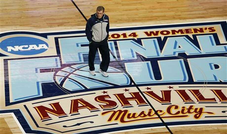 Connecticut head coach Geno Auriemma walks on the floor during practice before the women's Final Four of the NCAA college basketball tournament, Saturday, April 5, 2014, in  Nashville, Tenn. Connecticut plays Stanford Sunday.  (AP Photo/John  Bazemore)