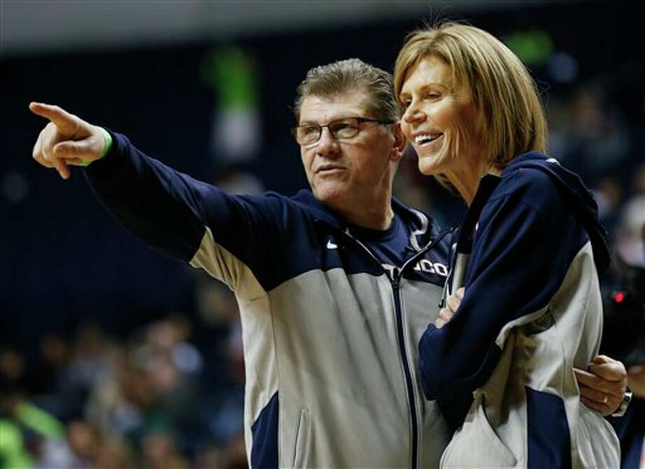 Connecticut head coach Geno Auriemma, left, and assistant head coach Chris Dailey talk during practice before the women's Final Four of the NCAA college basketball tournament, Saturday, April 5, 2014, in  Nashville, Tenn. Maryland plays Notre Dame Sunday. (AP Photo/John  Bazemore)