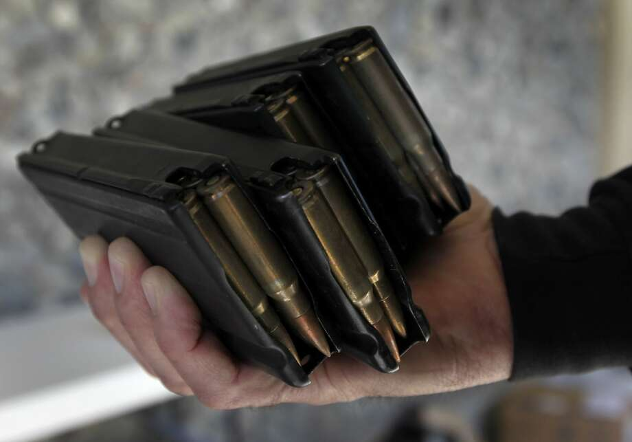 Fully loaded magazines were turned in with an assault rifle at a gun buyback program in San Francisco, Calif. on Saturday, April 5, 2014. Residents were offered up to $200 for each weapon turned in. Photo: Paul Chinn, The Chronicle