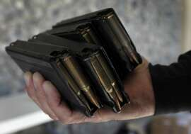 Fully loaded magazines were turned in with an assault rifle at a gun buyback program in San Francisco, Calif. on Saturday, April 5, 2014. Residents were offered up to $200 for each weapon turned in.