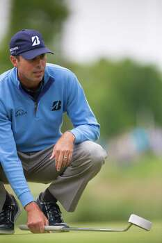 Matt Kuchar studies distance and angle to the ninth hole during the third round of the Shell Houston Open at the Golf Club of Houston, Saturday, April 5, 2014, in Humble. Kuchar is the third round leader. Photo: Marie D. De Jesus, Houston Chronicle / © 2014 Houston Chronicle