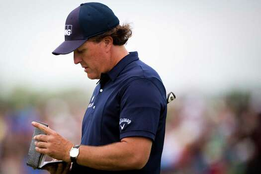 Phil Mickelson checks his score book at the 16th hole during the round three of the Shell Houston Open at the Golf Club of Houston, Saturday, April 5, 2014, in Humble. Photo: Marie D. De Jesus, Houston Chronicle / © 2014 Houston Chronicle