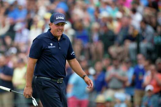 Phil Mickelson arrives to the 16th hole with the golf enthusiasts cheering for him during the round three of the Shell Houston Open at the Golf Club of Houston, Saturday, April 5, 2014, in Humble. Photo: Marie D. De Jesus, Houston Chronicle / © 2014 Houston Chronicle