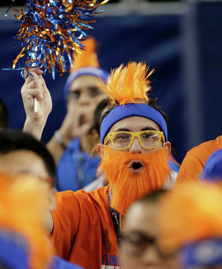A Florida fan cheers before an NCAA Final Four tournament college basketball semifinal game against Connecticut, Saturday, April 5, 2014, in Arlington, Texas. Photo: David J. Phillip, AP / Associated Press