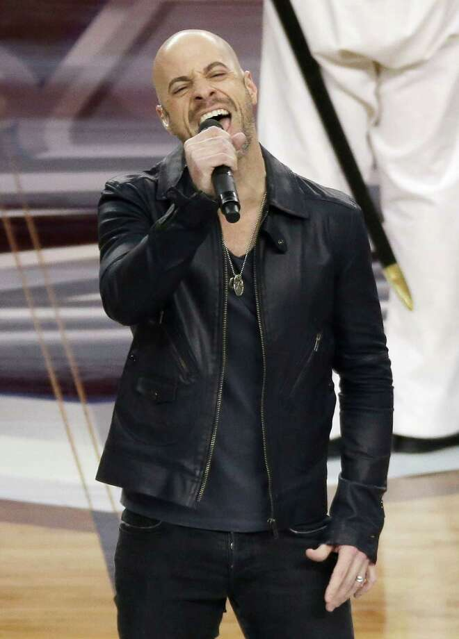 Chris Daughtry sings the national anthem before an NCAA Final Four tournament college basketball semifinal game between Florida and Connecticut, Saturday, April 5, 2014, in Arlington, Texas. Photo: Tony Gutierrez, AP / Associated Press
