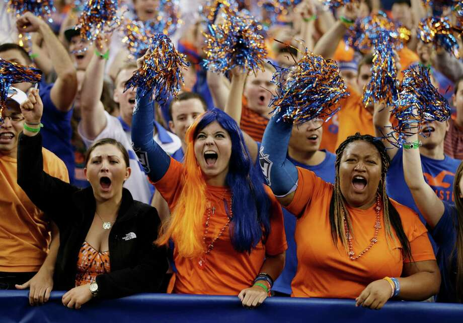 Florida fans cheer before an NCAA Final Four tournament college basketball semifinal game against Connecticut, Saturday, April 5, 2014, in Arlington, Texas. Photo: David J. Phillip, AP / Associated Press