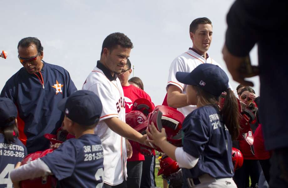 Denver Harbor Little Leaguers are given new baseball helmets provided by the Occidental Petroleum Corporation, by former Astro, Jose Cruz, and current Astros, Jose Altuve and Jason Castro at the Denver Harbor Little League's newly revitalized youth baseball fields at Denver Harbor Park Photo: Johnny Hanson, Houston Chronicle