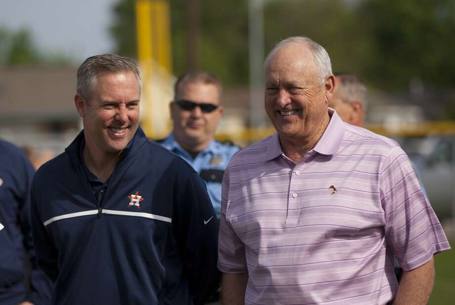 Astros president of business operations Reid Ryan and his father Nolan Ryan take in the scene at Denver Harbor Park. Photo: Johnny Hanson, Houston Chronicle