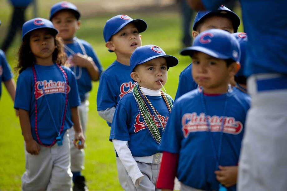 Denver Harbor Little Leaguers walk onto their newly revitalized youth baseball fields at Denver Harbor Park. Photo: Johnny Hanson, Houston Chronicle